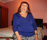 Grandmother undressing white bra